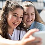 young girls taking selfie (edited)